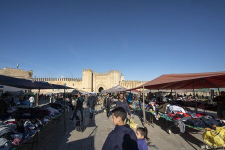 Fez, Morocco. November 9, 2019.  the stands of clothing vendors in the large Place Boujloud