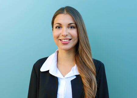 Photo for Young business woman with suit standing against blue background outdoor. - Royalty Free Image