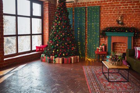 Photo for Modern interior of living room. Creative Christmas tree, contemporary fireplace and large olive sofa in loft interior design apartment - Royalty Free Image