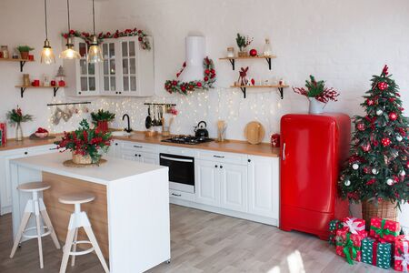 Photo pour Modern Kitchen Interior with Island, Sink, Cabinets in New Luxury Home Decorated in Christmas Style. - image libre de droit