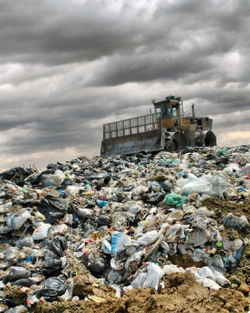 The bulldozer buries food and industrial wastes