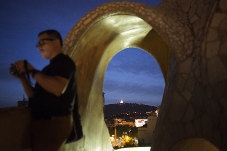 Casa Mila, La Pedrera, skyline of Barcelona, Spain. The chimneys. Panorama of the roof at dusk, evening, night. Unesco Heritage. Even if architecture isn't your thing, Gaudí's trippy Casa Milà (or La Pedrera, the quarry) on Passeig de Gràcia is a m