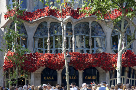 Antoni Gaudi Casa Batllo, UNESCO World Heritage Site, Barcelona, Catalonia, Spain. Sant Jordi (Saint George) is the Patron Saint of Catalonia all is full of roses.