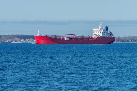 Photo pour image of red cargo barge at sea - image libre de droit