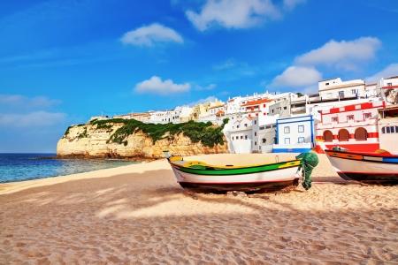 Portuguese beach villa in Carvoeiro classic fishing boats. Summer.