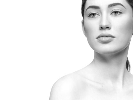 Photo pour Closeup of enchanted lady with beautiful eyes and plump lips posing on white isolated background. Young woman with perfect soft skin looking side in studio. Concept of natural beauty. - image libre de droit
