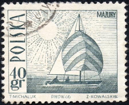 UKRAINE - CIRCA 2017: A stamp printed in Poland shows Amethyst yacht on Masurian Lake, circa 1966