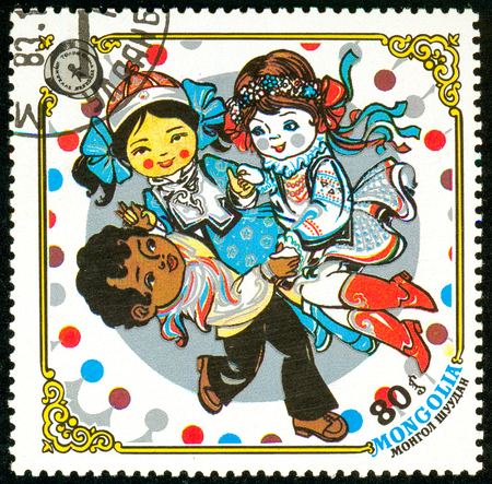 Ukraine - circa 2018: A postage stamp printed in Mongolia show Dancing kids. Series: 10 years Children Fund, Happy childhood. Circa 1983