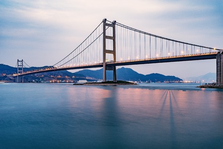 Photo for Bridge to Park island at sunset time. Hong Kong. - Royalty Free Image