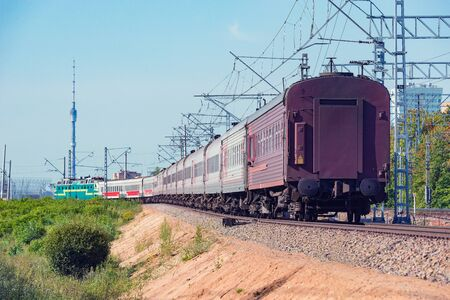 Photo pour Passenger train moves on city background. Moscow. Russia. - image libre de droit