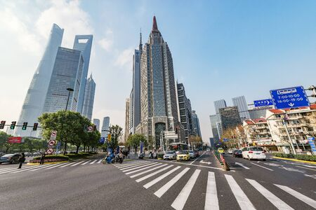 Photo pour Shanghai, China - December 31, 2016: Crossroads and streets in the city center at day time. - image libre de droit