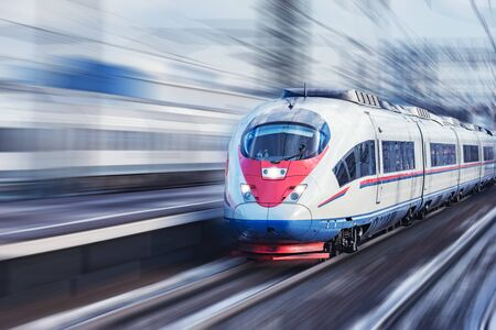 Photo pour Highspeed train approaches to the station platform at winter day time. - image libre de droit