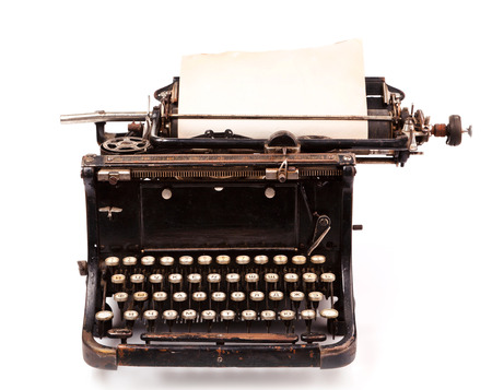 old fashioned, vintage typewriter with a blank sheet of paper