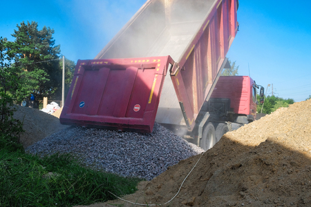 Photo for truck pours sand on the construction site - Royalty Free Image
