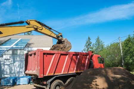 Photo for excavator digs clay soil at the construction site - Royalty Free Image