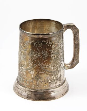 An old silver beer tankard. It is Eastern European  tankard decorated with ornament