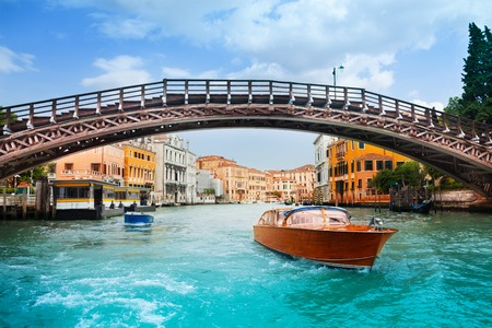Ponte dell'Accademia in Venice and motorboats on grand canal in Venice