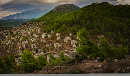 Panoramic Kayakoy houses in historcial Lycian village of Kayakoy, Fethiye, Mugla, Turkey. Ghost Town Kayaköy, anciently known as Lebessos and Lebessus. 3000 Greek life in the 19th century.