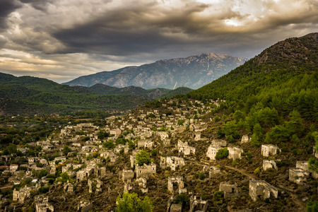 Kayakoy houses in historcial Lycian village of Kayakoy, Fethiye, Mugla, Turkey. Panoramic Ghost Town Kayaköy, anciently known as Lebessos and Lebessus. 3000 Greek life in the 19th century.