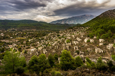 Kayakoy houses panoramic view in historcial Lycian village, Fethiye, Mugla, Turkey. Ghost Town Kayaköy, anciently known as Lebessos and Lebessus. 3000 Greek life in the 19th century.