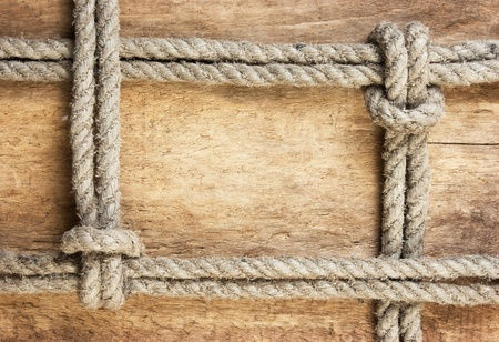 frame made of rope on a wooden background