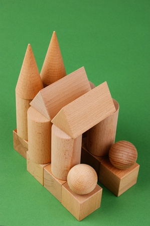 wooden geometric shapes on a green background