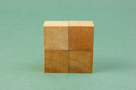 wooden geometric cube on a green
