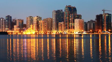 SHARJAH, UAE - OCTOBER 29, 2013: Night view of Sharjah, Sharjah is located along northern coast of Persian Gulf on Arabian Peninsula
