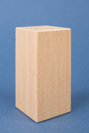 wooden geometric shape on a blue background