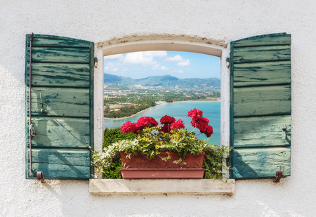 Photo pour Sea view through the open window with flowers in Italy - image libre de droit