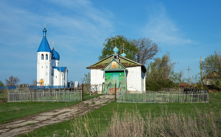 The old and the new church in the village of Russia