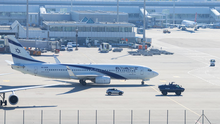 Munich, Germany - May 6, 2016: Armed police armored vehicle ensures antiterrorism attack defense measures for Israeli El-Al airliner in Munich international passenger airport.