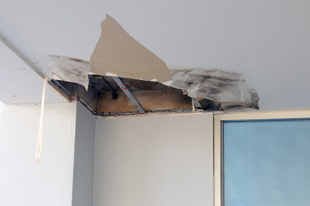 Photo pour Ceiling panels damaged hole in roof office from drain pipes leakage. - image libre de droit