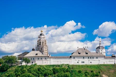 Beautiful Stone Bogoroditse-Uspensky Monastery at Summer Cloudy Day. Restoration of the Temple.