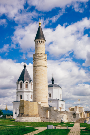 Ruins of Cathedral Mosque with Big Minaret. Dormition Church on Background. Bolghar, Russia.