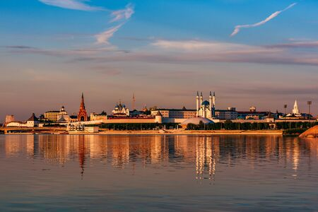 Kazan kremlin in sunset light reflecting on water surface