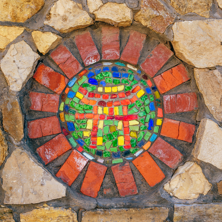 Photo for Circular mosaic religious symbol of Shinto on stone wall. - Royalty Free Image