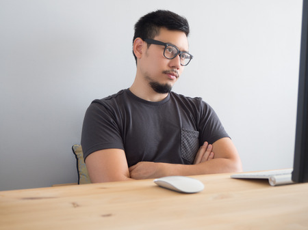 Photo for Asian man has got work problem. - Royalty Free Image