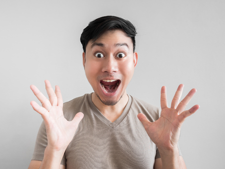 Photo pour Asian man feels shock and surprise with overly face expression. - image libre de droit