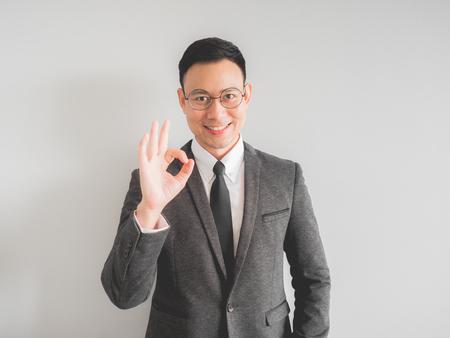 Photo pour Happy Asian boss manager business man wears black suit in relax pose. - image libre de droit