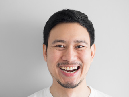 Photo for Head shot of laughing face Asian man. - Royalty Free Image