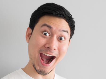 Photo pour Wow face of Happy Asian man head shot. - image libre de droit
