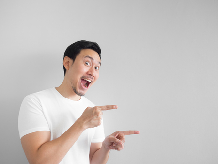 Photo for Surprised face of happy asian man in white shirt  light grey background. - Royalty Free Image