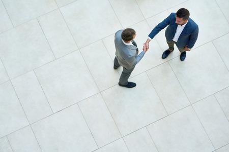 Photo pour Business People Shaking Hands, Top View - image libre de droit