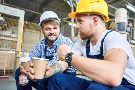 Photo pour Construction Workers Chatting on Coffee Break - image libre de droit