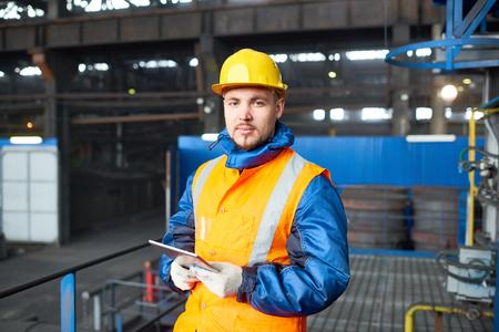 Photo pour Handsome Worker Using Digital Tablet - image libre de droit