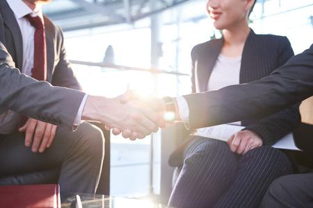 Photo pour Business Partners Shaking Hands - image libre de droit