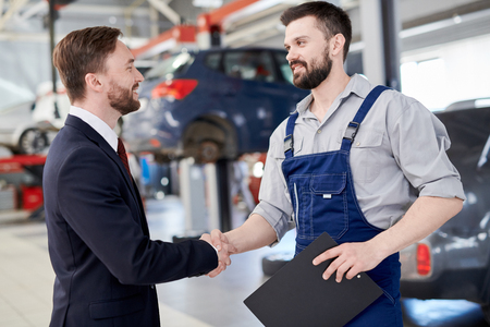 Photo for Mechanic Shaking Hands with Businessman - Royalty Free Image