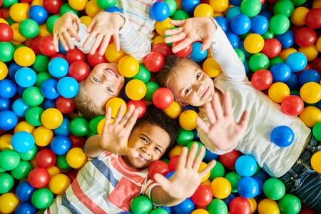 Photo for Three Kids Playing in Ballpit - Royalty Free Image
