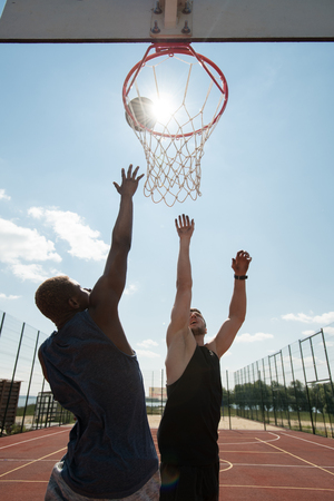 Two Basketball Players Outdoors